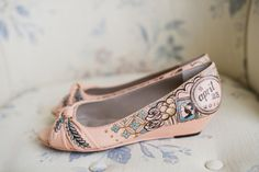 An up and coming trend this year is hand painted wedding shoes.  These are emily porter's wedding shoes which were hand painted by Figgie Shoes with the wedding date.