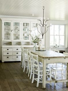 Love the farm table and china cabinet