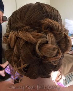 Curl entwined bun. Hair by Chanae Hiller at Ahead of Style Hair Artistry.