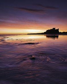The breathtaking Bamburgh Castle in Northumberland. (Image via Castle Coast Campers on Pinterest)