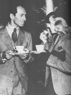 composersdoingnormalshit:  George Gershwin drinking tea with Ginger Rogers.