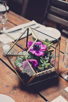 geometric reception centerpiece - photo by Khaki Bedford Photography http://ruffledblog.com/whimiscal-new-york-wedding-at-mymoon
