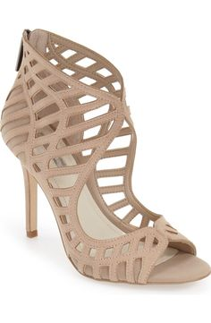 Gorgeous cutouts define this show-stopping sandal with a stiletto heel.