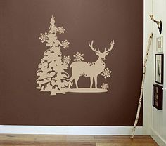 Deer with Pine Tree and Snow Flakes Vinyl Wall Decal Sticker Graphic. Made from high quality adhesive vinyl that will last indefinitely indoors and has an outdoor rating of up to 10 years. Some decals may be in multiple sections due to the size of the design. Our vinyl graphics are easy to apply to any smooth surface. Put them on walls, wood, glass, tile, windows, canvas, ceramics, the possibilities are endless! These work on many different wall surfaces including textured walls. Your...
