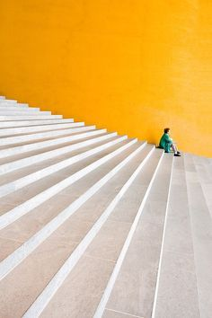 Yellow Wall of building, White concrete stone steps. Great modern architecture photography