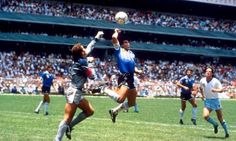 Diego Maradona rises above Peter Shilton to score his infamous 'Hand of God' goal against England in Mexico City in the 1986 World Cup.