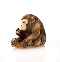 An ivory netsuke of a monkey. By Masamitsu, 19th century. Photo Bonhams