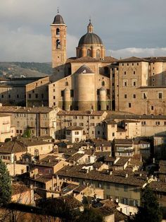 The Cathedral St. Dominique and Ducal Palace rise above the rooftops of Urbino, Marche, Italy. Photo by twiga_swala on Flickr.