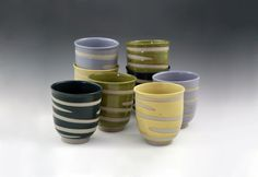Spiral Cups in various colors.  Approximately 3 7/8″ X 3 3/8″. $15 Made from stoneware.