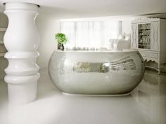 The Mondrian in South Miami Beach designed by Marcel Wanders. Paint a claw foot tub with metallic paint!