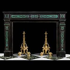 13977: A very fine, rare and striking French Regency exquisitely etched Belgian Black marble chimneypiece decorated with inlaid jewel like terrazzo malachite in the Renaissance manner and with elaborately en