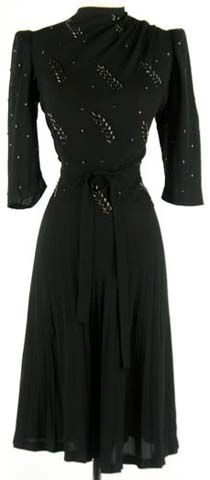 1940s Black Puff Sleeve Dress with Metal Studs and Matching Belt by Dorothy Gene. #vintage #1940s #fashion