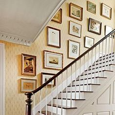 How To Hang Art in a Stairwell | Designer Phoebe Howard shares her foolproof decorating formula. | SouthernLiving.com