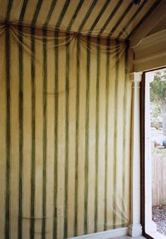 Tented striped fabric trompe l'oeil mural. cool! I love draped walls, but it could be annoying. paint would be perfect.