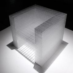 2450 white / clear by Junpei Tamaki. A chair created from 2450 5mm pieces of acrylic.
