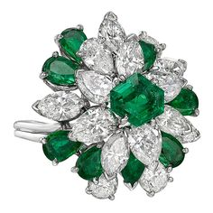 Oscar Heyman Emerald Diamond Cluster Ring | From a unique collection of vintage cluster rings at https://www.1stdibs.com/jewelry/rings/cluster-rings/