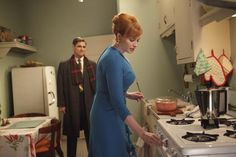 Mad Men - Pink Daisey oval casserole next to stove