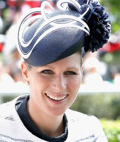 Zara Phillips arrives in the Royal Carriage into the parade ring wearing a Tokyo hat by British designer Milliner Rosie Olivia