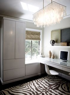 Chic capiz pendant and zebra rug in office space