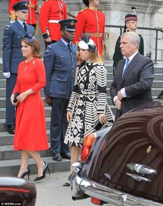 Princess Eugenie was stunning in red at the Queen's 90th birthday thanksgiving service today, but her sister Beatrice missed the mark somewhat in a patterned Burberry coat