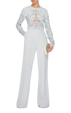 This elegant **Elie Saab** jumpsuit features a long sleeve lace bodice with crisp high waist flares.