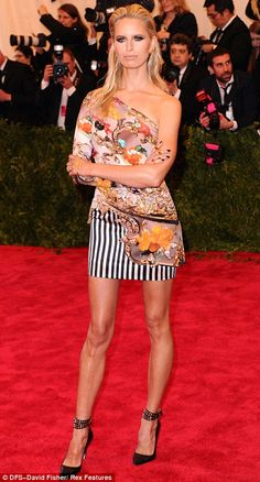 Cool get up!  Legs eleven: Karolina Kurkova displayed her super long legs in a printed mini dress paired with black leather stilettos featuring studded straps