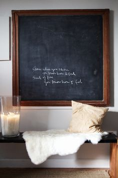 Oversized chalkboard in a wooden frame hanging on the wall of the Chicago home of Angela Stone.  Photography by Emily Johnston Anderson via Rue Magazine, Issue #2.