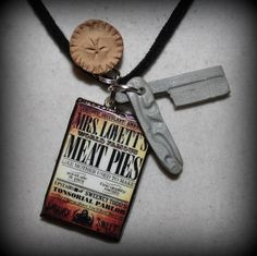 "Sweeney Todd's razor and Mrs. Lovett's meat pie with advertisement charm- ""Did you come here for a pie sir?"""