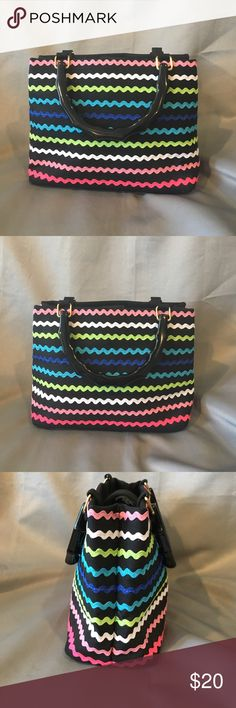 Tiannl Black and Multi Color Striped Purse Tiannl Black and Multi Color Striped Purse. Small accessory zipper pocket inside. Handles are black plastic like material. The purse itself is cloth. Purse has a snap button to close. Measures approx 11x8x4 inches. The handle drops are approx 4 inches long.  Gently used. Tiannl Bags Totes