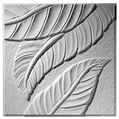 This contemporary ceiling tile has a larger scale leaf pattern and contemporary flair.