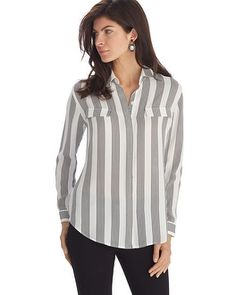 Business wear goes bold— long sleeve collared shirt in contrasting black and white vertical stripes is sure to make a modern statement. Hidden button front placket and faux chest pockets add for updated details.