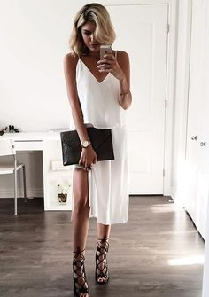 Keep it sexy with a white slip dress and strappy heels