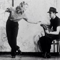 Dance director Hermes Pan and  Ginger Rogers rehearse moves for Swing Time (1936)