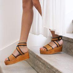 7d15cd8dbbcf Wooden platform sandals w  black trim Stiles