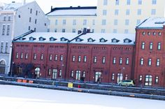 People walking by an old factory next to the frozen sea Colourful Buildings, Old Factory, Infographic Templates, Old Cars, Photo Art, Multi Story Building, Stock Photos, Mansions, House Styles