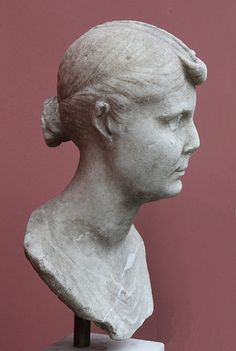 Roman Lady from Cerveteri (profile)  Roman marble portrait of a woman, dating from the period of Augustus (thus from ca. 31 BCE to 14 CE). Note the similarity of the hairstyle to portraits of Livia. Ny Carlsberg Glyptotek inv. 1282 It has been suggested that the portrait represents Octavia Minor, or at least a woman who is a member of the imperial Augustan family (see comments in V. Poulsen. 1961. Les Portraits Romains, vol. 1 Copenhagen: pg. 76 (cat. no. 41).