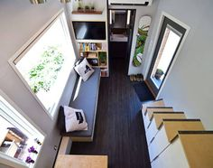 This self-built tiny home looks like a shed on the outside, but hides a beautiful, modern interior within.