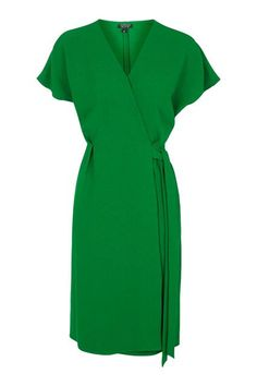You've Never Seen Wrap Dresses Like This Before #refinery29  http://www.refinery29.com/wrap-dresses#slide-9  Although loud in hue, an emerald-green dress is a guaranteed head-turner, especially when paired with turquoise earrings and some nude shoes.Topshop Wrap Dress, $80, available at Topshop....