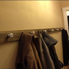 DIY Coat rack. 8' soft pine 1x4 beat up & stained. Screwed in drawer pulls from an antique store & hooks from Menards. This freed up a closet in my old apartment for Christmas storage!