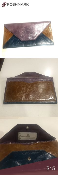 Steve Madden, Multi-Color Leather Clutch Steve Madden, Multi-Color Leather Clutch. Just like new. Never used. A tiny scratch is inside as shown on the picture. Steve Madden Bags Clutches & Wristlets