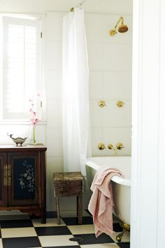 Experiment with different elements and textures to add personality to your country style bathroom. Here, an antique...
