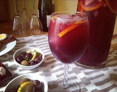 sangria recipe ::  tradition with a twist ::  this cocktail starts with a bottle of Spanish red wine (Tempranillo, Rioja, and Garnacha are good bets) kicked up with triple sec and orange juice, and gets a flavor and color boost from fresh fruit and cinnamon. The final touch: Just before serving, add a bottle of the Spanish sparkling wine Cava. With just a hit of effervevescence, it's refreshing paired with classic tapas like herb-marinated olives, jamon serrano, and Manchego cheese. ¡Salud!