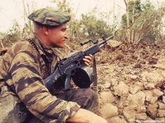 A tiger stripe clad SEAL team member in the Mekong Delta keeps guard with a Stoner 63A Commando during Operation Bold Dragon III. Photo taken: March 1968 - PH1 L. R. Robinson / The National Archives ~ Vietnam War