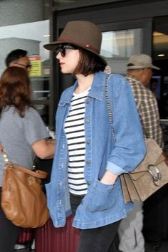 Dakota Johnson Photos Photos - Dakota Johnson is seen at LAX. - Dakota Johnson Seen at LAX