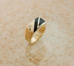 Trendy and Classy this Mens Black Onyx ring will make a great gift for the man in your life and a nice addition to his jewelry collection. Yellow Gold Inlaid Black Onyx 1 Round brilliant cut diamond = Ring size 10 Dimensions are: inch high by inch wide Mens Gold Rings, Gold Diamond Rings, Rings For Men, Blue Topaz Ring, Moonstone Ring, Wedding Rings Vintage, Vintage Rings, Gold Jewelry Simple, Black Onyx Ring