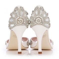 Cinderella is a beautiful new take on Emmy London's bestselling Francesca shoe. The beautiful vintage sandal shape is fully embellished in crystal embroidery, inspired by the famous glass slipper, made in the softest ivory kid suede with silver leather trim. These wedding shoes are hand beaded using Swarovski crystals and mirrored glass, they are real labour of love. Hand finished with beaded details, especially to the crystal elements to minimise catching on very delicate, fine or lace…