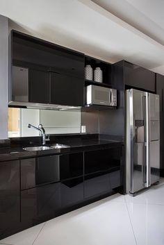 Cobertura Duplex Edificio Mandarim - Condomínio Peninsula: Cozinhas modernas por Cadore Arquitetura