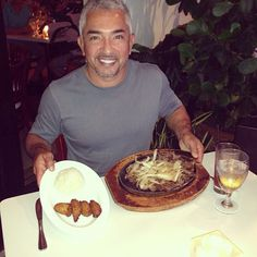 Cesar enjoys local food [Vaca Frita] in Miami, FL.