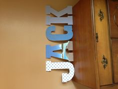 Used Wooden block letters and printed paper for my nautical baby room :-) quick and easy craft project!
