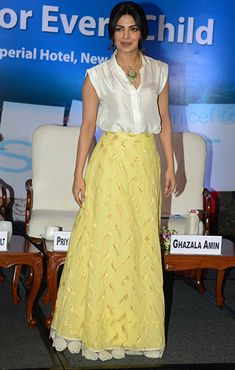 Priyanka Chopra in a Payal Khandwala shirt, Jade skirt, and neckpiece by Amrapali.